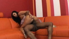 Cleanly shaved dark-haired babe is having nice sex on red couch